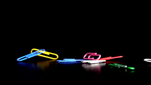 Colourful Paper clip dropping in Slow motion video