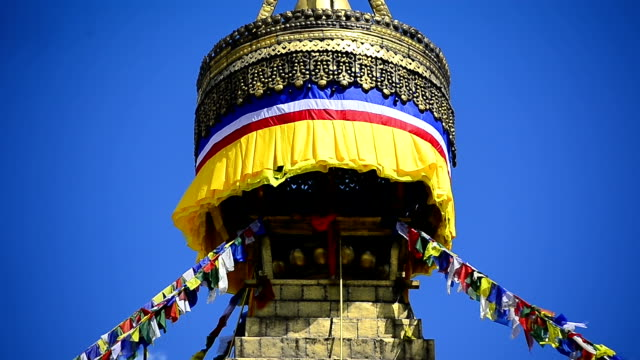 Colourful prayer flags and golden Bhuddist stupa temple Kathmandu Nepal video