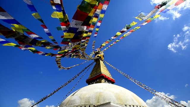 Colourful prayer flags and golden Bhuddist stupa temple Kathmandu Nepal video