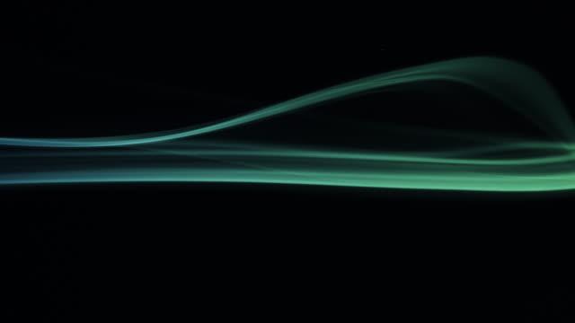 黒い背景にカラフルな煙 - 化学点の映像素材/bロール