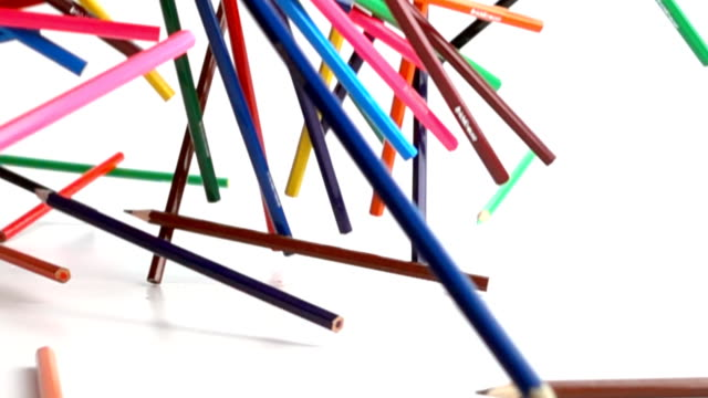 Colouring pencils falling in slow motion video