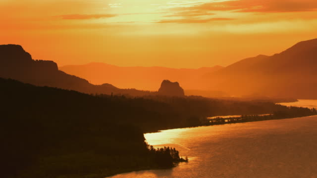AERIAL Columbia River at sunrise with Beacon Rock in the distance video