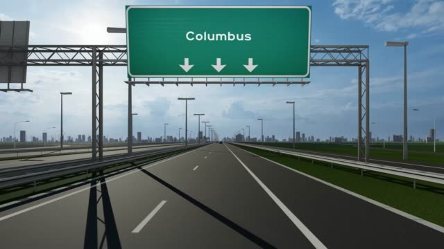 columbus signboard on the highway stock video indicating the concept of entrance to usa city - columbus day filmów i materiałów b-roll