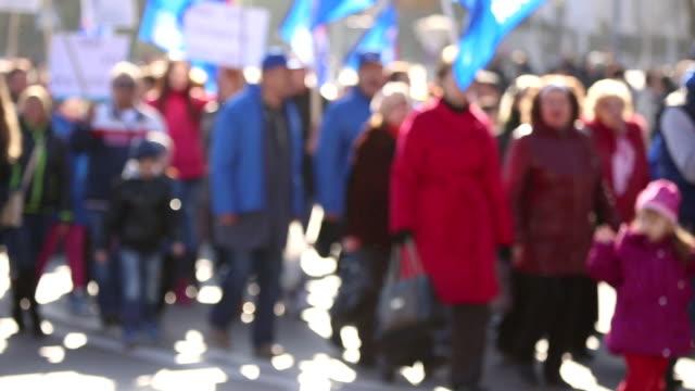 column of demonstrators video