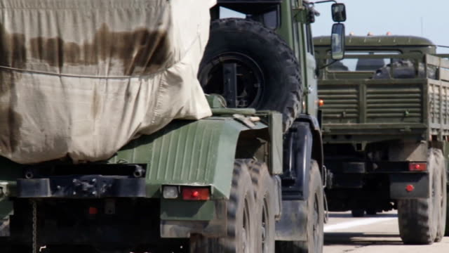 Column of military equipment video