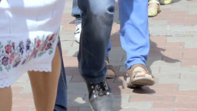 A column of people walking video