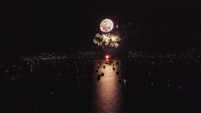Come join in the festivities! 4k aerial drone footage of a firework display at the harbour at night yacht stock videos & royalty-free footage