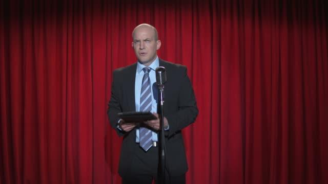 HD: Comedian In Suit Using Digital Tablet video
