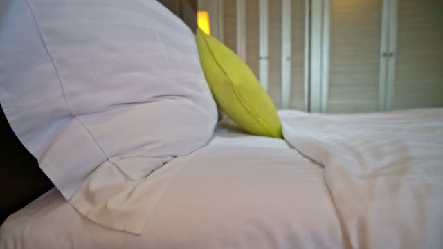 comfortable pillow decoration on bed in hotel bedroom comfortable pillow decoration on bed in hotel bedroom double bed stock videos & royalty-free footage
