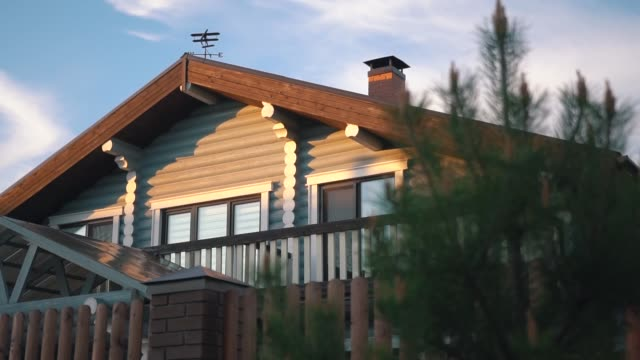 comfortable wooden cottage house stylish facade at sunset video