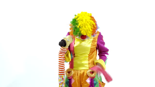 Coming circus clown playing with puppet amusingly video
