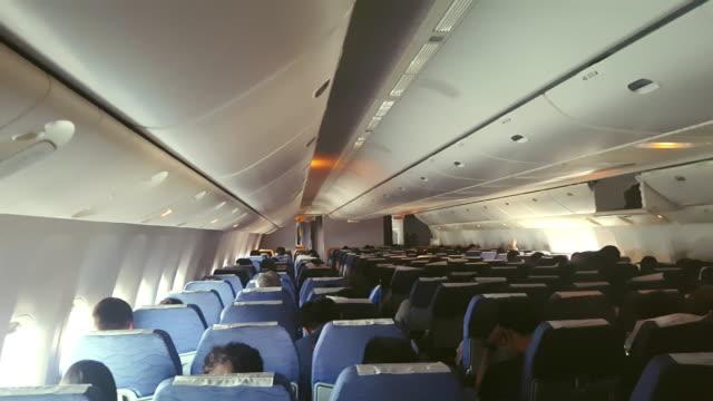 commercial aircraft cabin crowded with passengers - kabina filmów i materiałów b-roll