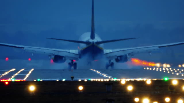 Commercial Airplane Landing at Night