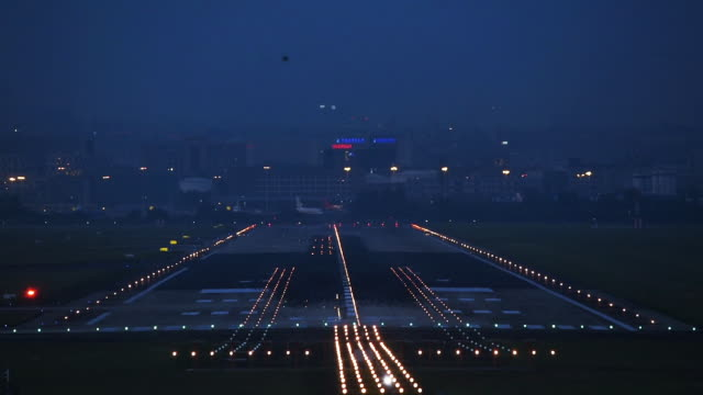 Commercial airplane landing in Chengdu airport at night. Commercial airplane landing in Chengdu airport at night, Sichuan province, China airport runway stock videos & royalty-free footage