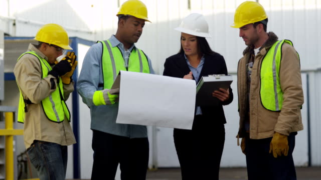 Commercial construction crew look over plans video