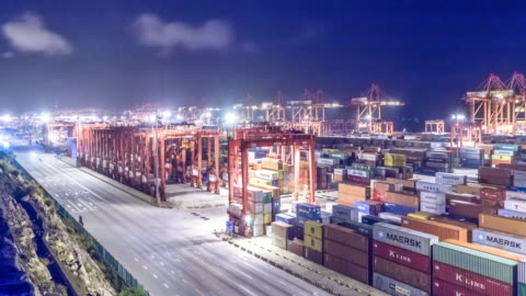 commercial dock with cargo containers . time lapse 4k commercial dock with cargo containers in shanghai yangshan harbor. time lapse 4k harbor stock videos & royalty-free footage