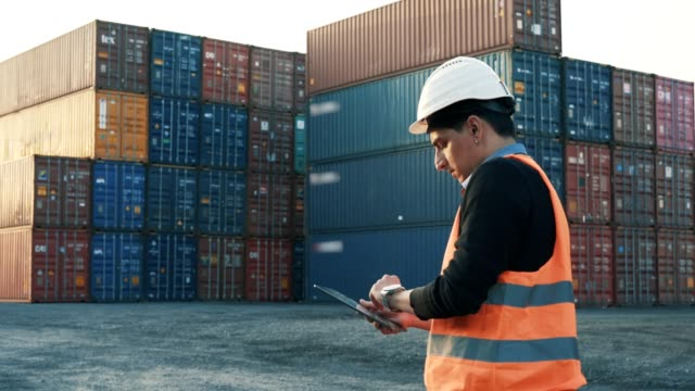 Commercial Dock Worker Dock worker checking goods with tablet computer. 4k resolution commercial dock stock videos & royalty-free footage