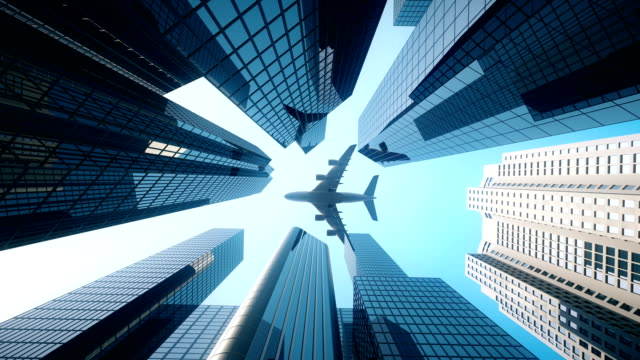 commercial flight over business district - blue - industria edile video stock e b–roll