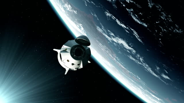 4K. Commercial Spacecraft Orbiting Earth. Ultra High Definition.