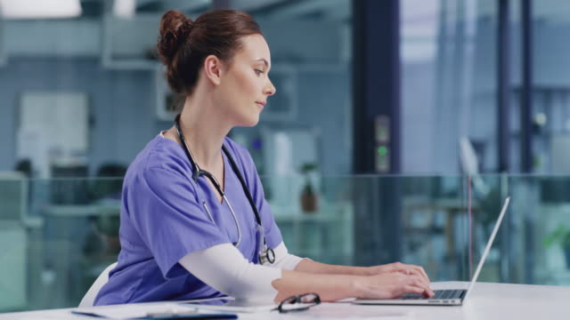 Commitment is everything in my career 4k video footage of a young nurse using a laptop in a hospital nurses stock videos & royalty-free footage
