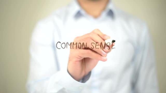 Common Sense, Man writing on transparent screen