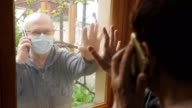istock Communication of elderly people during the coronavirus pandemic. Social distancing of people at risk. 1223798113