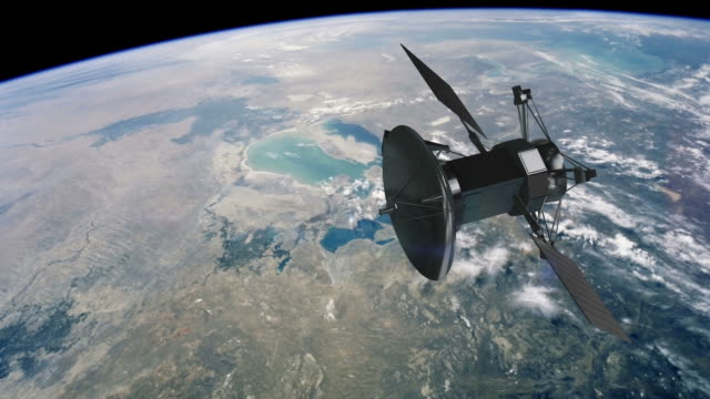 communications satellite orbiting earth - cinematic - satellitbild bildbanksvideor och videomaterial från bakom kulisserna