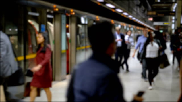 Commuter Crowd Of People in Underground Train Station - Commercially Usable Taken during the Summer of 2018 in London, UK underground stock videos & royalty-free footage