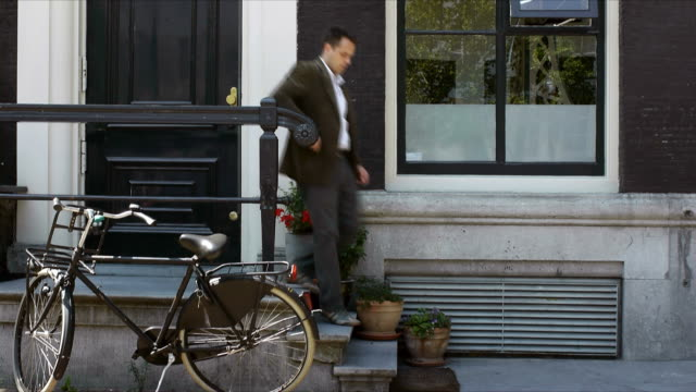 Commuter goes to work on bicycle video