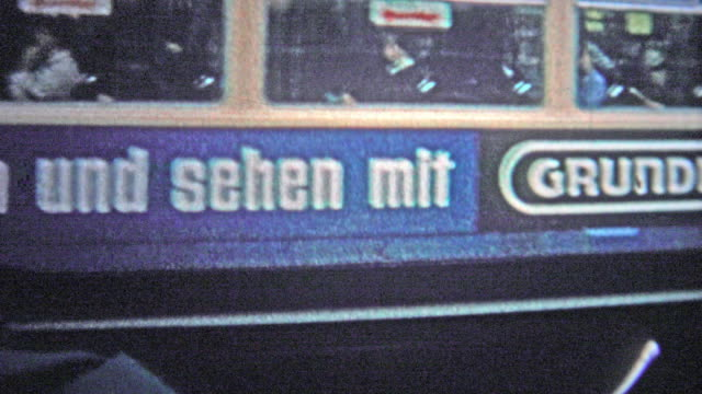 HAMBURG, GERMANY - 1966: Commuter light rail train closeup shows the use of early public transport advertising. video