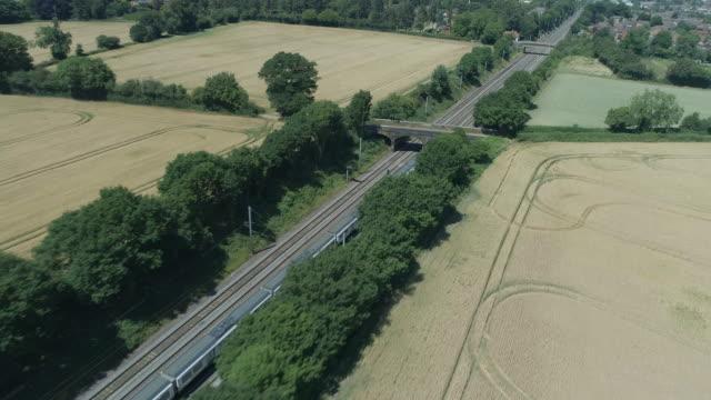 commuter train arriving into a town - intercity filmów i materiałów b-roll