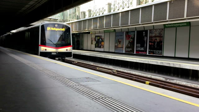 Commuter train entering station in Vienna Commuter train entering station in Vienna, Austria,  hand-held shot subway platform stock videos & royalty-free footage