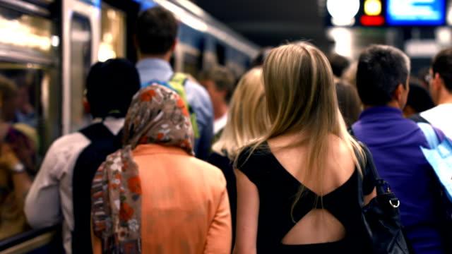commuters and boarding subway train (defocused) - munich train station bildbanksvideor och videomaterial från bakom kulisserna