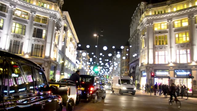 Commuters at christmas shopping with decorations on street, video