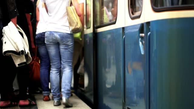 commuters boarding subway train selective focus shot - munich train station bildbanksvideor och videomaterial från bakom kulisserna