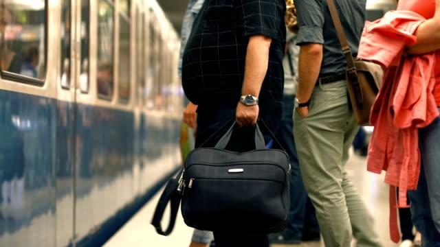 commuters boarding subway train selective focus (4k/uhd to hd) - munich train station bildbanksvideor och videomaterial från bakom kulisserna
