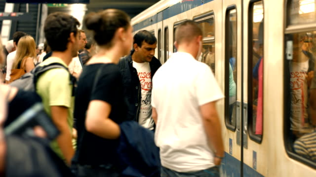 T/L Commuters Boarding Subway Train (4K/UHD to HD) video