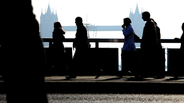 commuters: city workers with London Bridge in background video