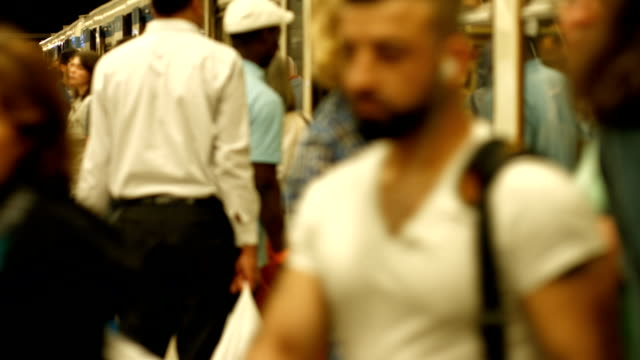 T/L Commuters Departing And Boarding Subway Train (4K/UHD to HD) video