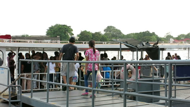Commuters getting on ferry in Bangkok video