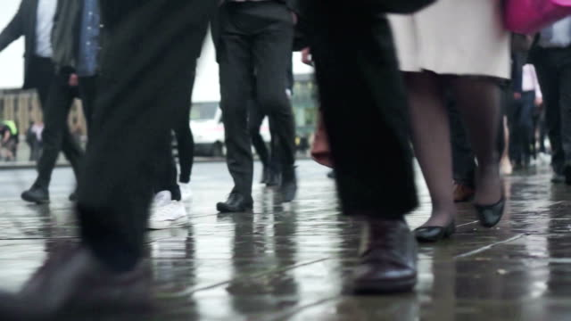 Commuters going to work in the rain    COM video