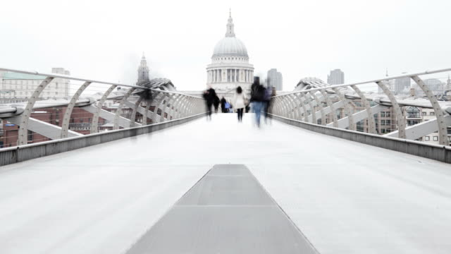 commuters in millennium bridge - london architecture stock videos & royalty-free footage