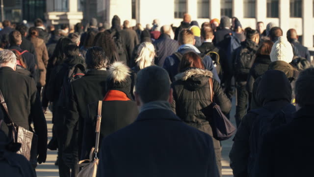 commuters walking to work. high angle view. slow motion. - pedone ruolo dell'uomo video stock e b–roll