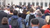 istock Commuters walking to work. Rear view headshot. SM 1161158284