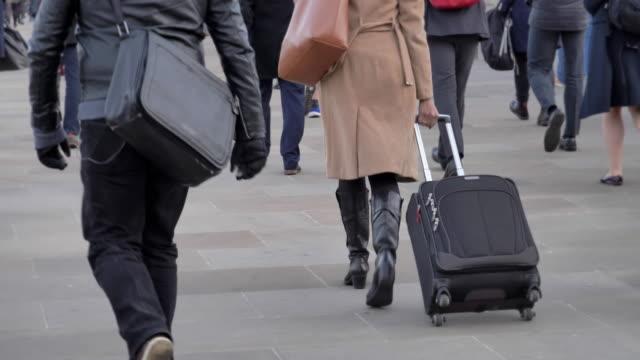 commuters walking to work, rear view. - london bridge inghilterra video stock e b–roll
