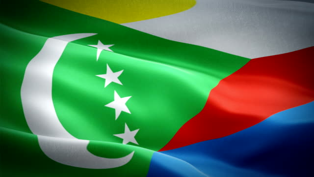 comoros flag motion loop video waving in wind. realistic comoro flag background. comoros flag looping closeup 1080p full hd 1920x1080 footage. comoros africa country flags footage video for film,news - kiss filmów i materiałów b-roll