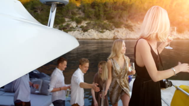 Company of Young Girls and Boy in Fahionable Clothes Leave Yacht To Party. Beautiful Seaside View and Happy People. Company of Young Girls and Boy in Fahionable Clothes Leave Yacht To Party. Beautiful Seaside View and Happy People. yacht stock videos & royalty-free footage
