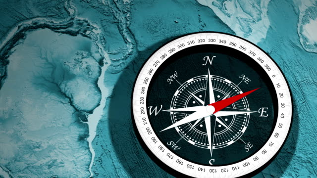 Compass, a device used to determine geographic direction device used to determine geographic direction, usually consisting of a magnetic needle or needles horizontally mounted or suspended and free to pivot until aligned with the earth's magnetic field. magnet stock videos & royalty-free footage