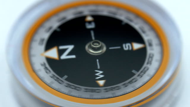 Compass needle gone mad, hitting the anomalous zone Compass needle quickly and erratically spinning, hitting in the anomalous zone. Closeup navigational compass stock videos & royalty-free footage