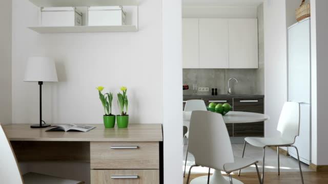 4k sammanställning video. interiör av modern lägenhet i skandinavisk stil med kök och arbetsplats. motion panoramautsikt med äpplen och blommor - wine box bildbanksvideor och videomaterial från bakom kulisserna